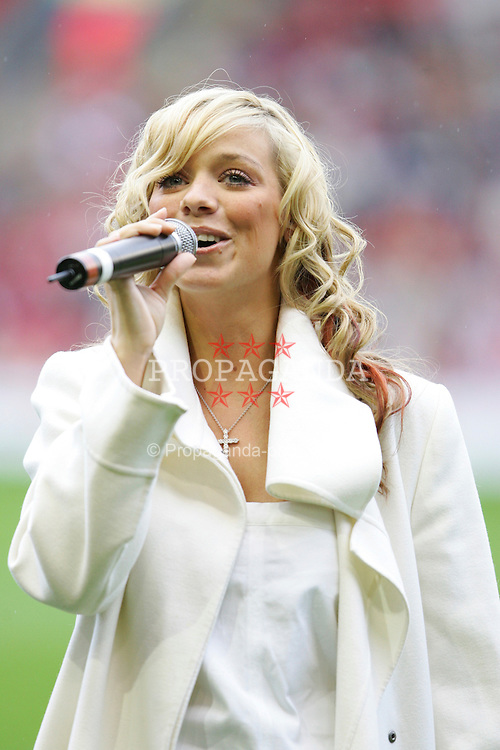 LIVERPOOL, ENGLAND - SUNDAY MARCH 27th 2005: Elizabeth Liz McClarnon a pop singer with girl band Atomic Kitten sings before the Liverpool Legend v Celebrity XI Tsunami Soccer Aid match at Anfield. (Pic by David Rawcliffe/Propaganda)