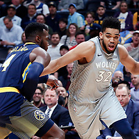 05 April 2018: Minnesota Timberwolves center Karl-Anthony Towns (32) drives past Denver Nuggets forward Paul Millsap (4) during the Denver Nuggets 100-96 victory over the Minnesota Timberwolves, at the Pepsi Center, Denver, Colorado, USA.