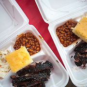 """June 9, 2012 - Vernon, NJ : """"Texas Smoke BBQ"""" St. Louis style pork ribs -- with beans, slaw and corn bread -- are packed for customers during the 3rd annual """"Rock, Ribs & Ridges"""" music and food festival in Vernon, NJ on Saturday. CREDIT: Karsten Moran for The New York Times"""