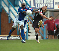 Photo: Ian Hebden.<br />Chesterfield United v Swansea City. Coca Cola League 1. 14/10/2006.<br />Swanseas Lee Trundle (R) fires in a shot in front of Chesterfields Reuben Hazell (L).