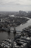 The River Thames snakes its way from Canary Wharf and Docklands and through Tower Bridge seen from the 72nd Floor of the Shard.