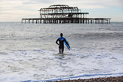 © Licensed to London News Pictures. 14/01/2017. Brighton, UK. Members of the Brighton Surf Life Saving club brave the cold temperatures to take part in their weekly training exercise. Photo credit: Hugo Michiels/LNP
