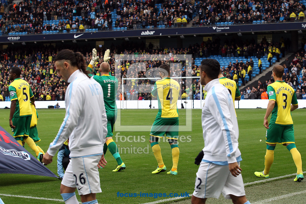 Picture by Paul Chesterton/Focus Images Ltd +44 7904 640267<br /> 02/11/2013<br /> John Ruddy of Norwich applauds the traveling fans as the teams make their way on to the pitch before the Barclays Premier League match at the Etihad Stadium, Manchester.