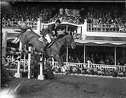 04/08/1960<br /> 08/04/1960<br /> 04 August 1960<br /> R.D.S Horse Show Dublin (Thursday). David Broome Of Great Britain on &quot;Sunsalve&quot;, winner of the International Jumping Competition at the Dublin Horse Show, clearing a pole jump in Fine style.