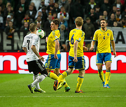 15.10.2013, Friends Arena, Stockholm, SWE, FIFA WM Qualifikation, Schweden vs Deutschland, Gruppe C, im Bild  Sverige 9 Kim K�llstr�m i duell med/ battles for the ball Germany 7 Bastian Schweinsteiger // during the FIFA World Cup Qualifier Group C Match between Sweden and Germany at the Friends Arena, Stockholm, Sweden on 2013/10/15. EXPA Pictures � 2013, PhotoCredit: EXPA/ PicAgency Skycam/ Peter Werner<br /> <br /> ***** ATTENTION - OUT OF SWE *****