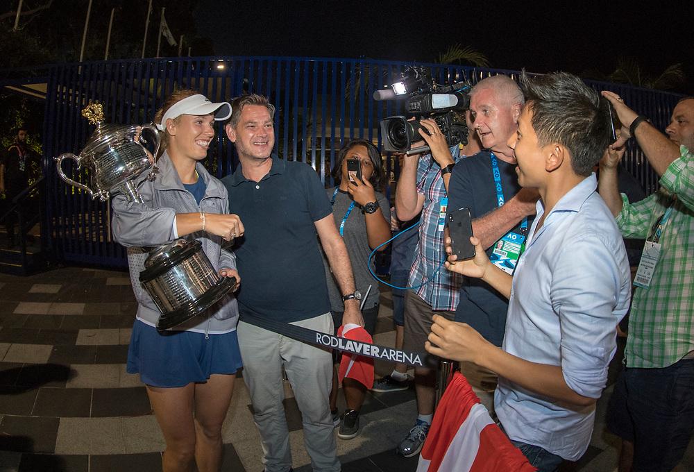Caroline Wozniacki of Denmark greets fans after winning the women's singles championship match during the 2018 Australian Open on day 13 in Melbourne, Australia on Saturday night January 27, 2018.<br /> (Ben Solomon/Tennis Australia)