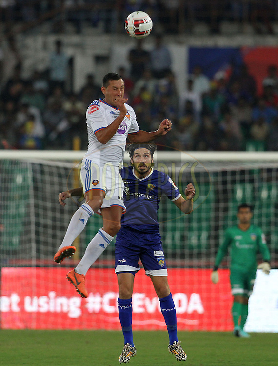 Miroslav Slepicka of FC Goa and Bojan Djordjic of Chennaiyin FC in action during match 50 of the Hero Indian Super League between Chennaiyin FC and FC Goa held at the Jawaharlal Nehru Stadium, Chennai, India on the 5th December 2014.<br /> <br /> Photo by:  Vipin Pawar/ ISL/ SPORTZPICS