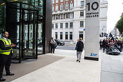 London, UK. 2 July, 2019.  Climate change activists from Extinction Rebellion Art and Culture protest outside the offices of Saudi Aramco during a silent procession visiting the offices of five major oil companies - ENI, CNPC, Saudi Aramco, Repsol and BP - to declare them a crime scene.