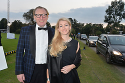 BENNY HIGGINS CEO of Tesco Bank and LOUISE RYDEN at the Chovgan Twilight Polo Gala in association with the PNN Group held at Ham Polo Club, Petersham Close, Richmond, Surrey on 10th September 2014.