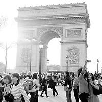 Two women take a selfie in front of the Arc de Triomphe on the Avenue des Champs-Élysées in Paris, France, in April of 2015.