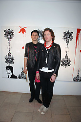 Left to right, PHIL COLBERT and RICHARD ASCOTT at The Week of Living Dangerously an exhibition and concert by Richard Ascott and Phil Colbert of fashion label Rodnik held at The Hospital, Endell Street, London on 25th March 2008.<br />