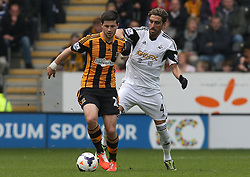Hull's Shane Long holds off Swansea's Chico Flores - Photo mandatory by-line: Matt Bunn/JMP - Tel: Mobile: 07966 386802 05/04/2014 - SPORT - FOOTBALL - KC Stadium - Hull - Hull City v Swansea City- Barclays Premiership