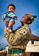 07/10/2010.The first troops from The Royal Scots Borderers, 1st Battalion The Royal Regiment of Scotland (1 SCOTS) arrived back to their base in Edinburgh last weekend (1-2 October 2010) after a 6 month operational tour in.Afghanistan...Pvt Ignatius Mizuh with  baby son Roy (5mths) ..Ignatius's son Roy was born while he was away in Afghanistan and Roy only met his dad for the 1st time at the weekend... ..Pic:Andy Barr.07974 923919  (mobile).andy_snap@mac.com.All pictures copyright Andrew Barr Photography. .Please contact before any syndication. .