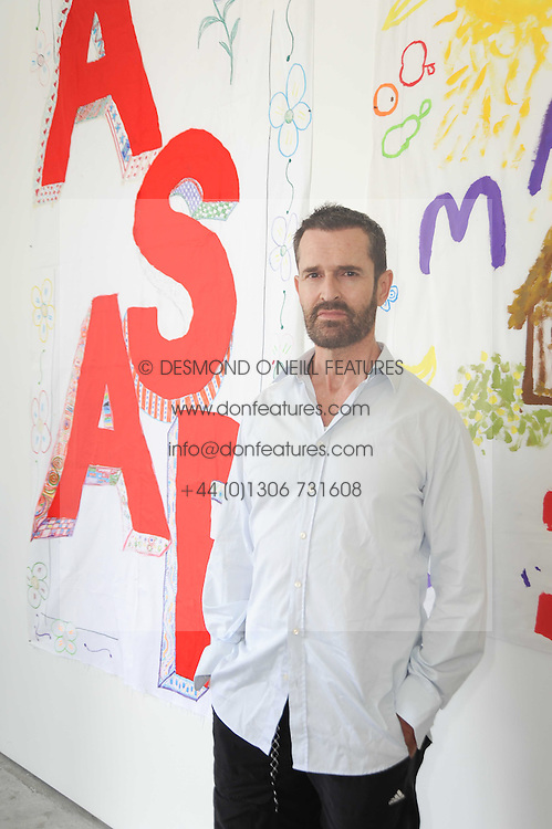 RUPERT EVERETT at a charity lunch organised in aid of ASAP (African Solutions to African Problems) held at the Louise T Blouin Foundation, 3 Olaf Street, London W11 on 23rd June 2010.