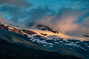 Sunset on peaks above Dart Valley seen from Daley's Flat Hut in Mount Aspiring National Park, Otago region, South Island of New Zealand.