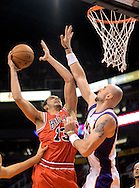 Nov. 14, 2012; Phoenix, AZ, USA; Chicago Bulls center Joakim Noah (13) puts up the ball during the game against the Phoenix Suns center Marcin Gortat (4) in the first half at US Airways Center. Mandatory Credit: Jennifer Stewart-US PRESSWIRE.
