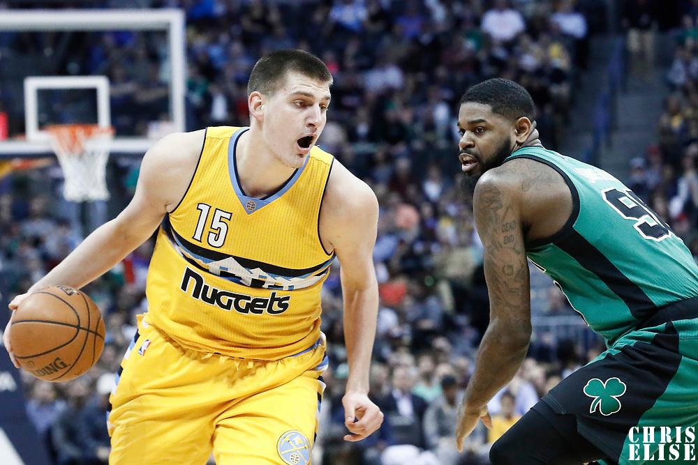 10 March 2017: Denver Nuggets forward Nikola Jokic (15) drives past Boston Celtics forward Amir Johnson (90) during the Denver Nuggets 119-99 victory over the Boston Celtics, at the Pepsi Center, Denver, Colorado, USA.