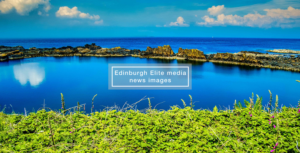 Easdale Island, the smallest permanently-inhabited island of the Inner Hebrides, Scotland.  A flooded slate quarry is all that remains of what was once the centre of the Scottish slate mining industry.<br /> <br /> (c) Andrew Wilson | Edinburgh Elite media
