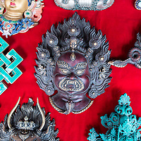 Bhutanese mask in a market in Thimpu<br />