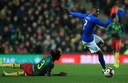 Cameroon's Gaetan Bong and Brazil's Douglas Costa during the international friendly match at Stadium MK, Milton Keynes.