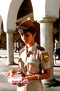 MEXICO, YUCATAN Merida Main Plaza Meter maid writing tickets