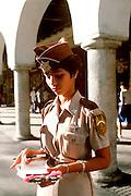 MEXICO, YUCATAN Merida Main Plaza Meter maid writing tickets