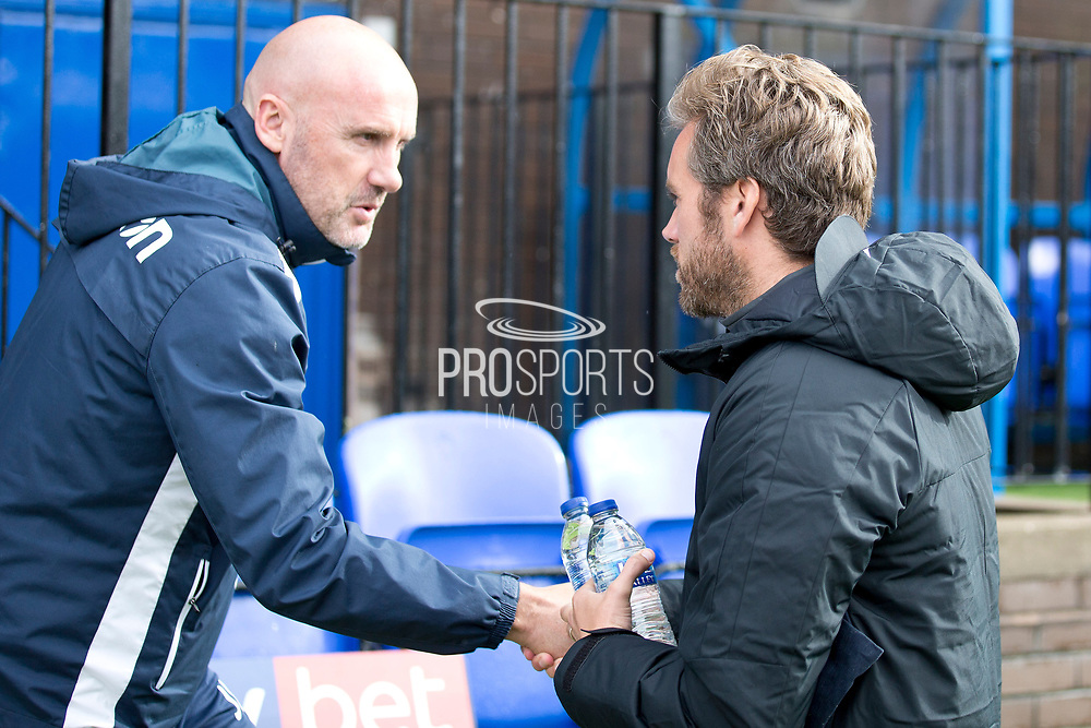 Macclesfield Town manager Daryl McMahon and \Colchester United manager John McGreal  shaking hands                                                                                                                               during the EFL Sky Bet League 2 match between Macclesfield Town and Colchester United at Moss Rose, Macclesfield, United Kingdom on 28 September 2019.