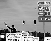 BIRMINGHAM, AL – JULY, 2007: John Brown blasts music and prophesy at  passing vehicles on Lakeshore Drive. Brown, a Christian evangelist, has been preaching from this same patch of grass in the outskirts of Birmingham for over a decade.