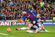 Liverpool defender Andy Robertson (26) tackles Barcelona forward Lionel Messi (10) during the Champions League semi-final leg 1 of 2 match between Barcelona and Liverpool at Camp Nou, Barcelona, Spain on 1 May 2019.