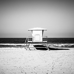 California lifeguard tower black and white picture. Located along the Pacific Ocean in Huntington Beach Orange County Southern California. Photo is Copyright © 2012 Paul Velgos with All Rights Reserved.