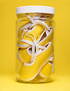 still life of baby shoes in a bottle