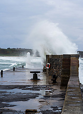 Huge waves crash over the harbour walls, Cullen, 4 May 2019