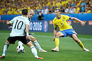Sweden FW Zlatan Ibrahimović (C) (10) plays a pass with the outside of his foot during the Euro 2016 match between Sweden and Belgium at Stade de Nice, Nice, France on 22 June 2016. Photo by Andy Walter.