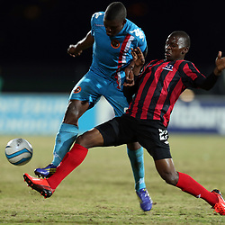 DURBAN, SOUTH AFRICA - AUGUST 03: Thamsanqa Mkhize of Maritzburg Utd with a tackle on Tshepho Tema of Polokwane City during the Absa Premiership match between Maritzburg United and Polokwane City at Harry Gwala Stadium on August 03, 2013 in Durban, South Africa. (Photo by Steve Haag/Gallo Images)