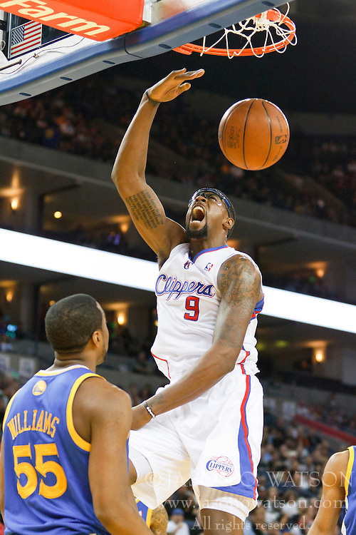 October 29, 2010; Oakland, CA, USA;  Los Angeles Clippers center DeAndre Jordan (9) dunks in front of Golden State Warriors small forward Reggie Williams (55) during the second quarter at Oracle Arena.