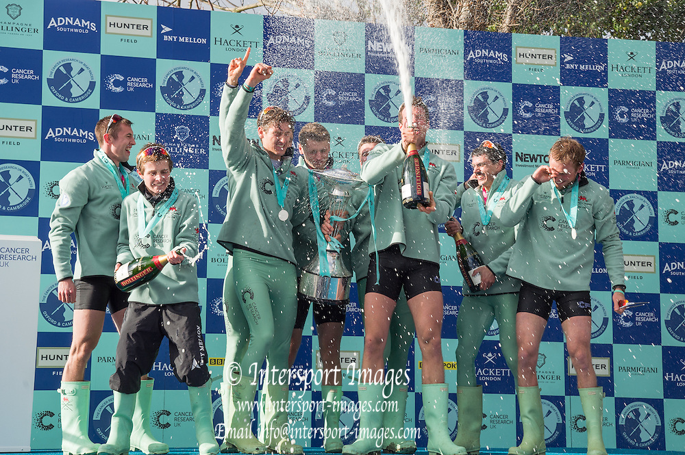 London. UNITED KINGDOM. &quot;Champagne Moment&quot;, Cambridge celebrate winning the  162nd BNY Mellon Boat Race Championship Course, River Thames, Putney/Mortlake.  Sunday  27/03/2016    [Mandatory Credit. Intersport Images]<br /> <br /> Cambridge University Boat Club {CUBC} v Oxford University Boat Club {OUBC}<br /> <br /> Cambridge, Crew, Bow: Felix Newman &ndash; 83.2kg, 2: Ali Abbasi &ndash; 88.4kg, 3: Charles Fisher &ndash; 91.8kg, 4: Clemens Auersperg &ndash; 90.4kg, 5: Luke Juckett &ndash; 82.0kg, 6: Henry Hoffstot &ndash;  92.6kg, 7: Ben Ruble &ndash; 83.4kg, Stroke: Lance Tredell &ndash; 94.2kg, Cox: Ian Middleton &ndash; 54.0kg