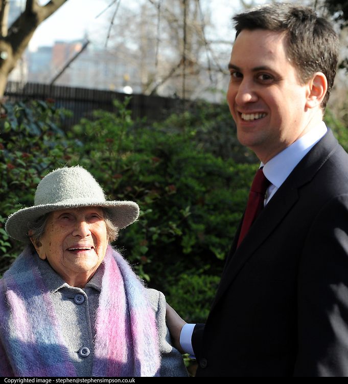 London News pictures. 08/03/11. 105-year-old former suffragette Hetty Bower (L) meets Labour Leader Ed Miliband (R) at the statue of Emmeline Pankhurst to mark International Women's Day. She was  joined by Labour Leader Ed Miliband, Labour Deputy Leader Harriet Harman, and shadow home secretary Yvette Cooper. Emmeline  at the Pankhurst statue at Victoria Tower Gardens, Parliament Square, Westminster, London, Picture Credit should read Stephen Simpson/LNP