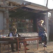 Roma gypsy outside a shop in the roma ghetto of Fakulteta Mahala, in Sofia, Bulgaria