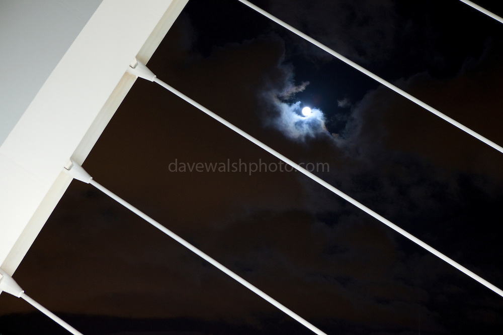 Detail of Samuel Beckett Bridge, Dublin with the moon behind before installation, following it's arrival from the Netherlands. Constructed by Graham Hollandia Joint Venture, architect, Santiago Calatrava. 120 metres long and 48 metres high and weighs 5,700 tonnes.