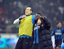 Marco Materazzi celebrates whilst wearing a mask of AC Milan and Italian President  Silvio Berlusconi after the Serie A match between Inter Milan and AC Milan at Stadio Giuseppe Meazza on January 24, 2010 in Milan, Italy.
