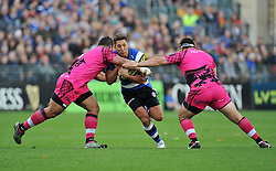 Gavin Henson of Bath Rugby is double-tackled - Photo mandatory by-line: Patrick Khachfe/JMP - Mobile: 07966 386802 01/11/2014 - SPORT - RUGBY UNION - Bath - The Recreation Ground - Bath Rugby v London Welsh - LV= Cup