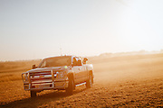 Driving off road on a farm in Iowa.<br /> Photographed by editorial lifestyle Texas photographer Nathan Lindstrom