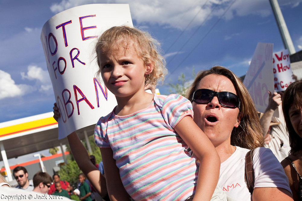 Sept. 10, 2008 -- PHOENIX, AZ: A woman holds her daughter up during a rally for Barack Obama in Phoenix Wednesday. The Barack Obama presidential campaign opened an office in Phoenix Wednesday just five miles from the home of Republican presidential candidate John McCain. About 400 Obama supporters came the opening.   Photo by Jack Kurtz