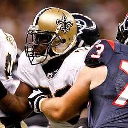 August 21, 2010; New Orleans, LA, USA; New Orleans Saints defensive tackle Sedrick Ellis (98) works against Houston Texans offensive tackle Eric Winston (73) during the first quarter of a preseason game at the Louisiana Superdome. Mandatory Credit: Derick E. Hingle