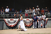 Diany Sandoval walks on the field before marrying San Rafael Pacifics' Maikel Jova before the team's minor league baseball game at Albert Field in San Rafael, Calif., on Sunday, July 26, 2015.