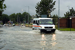 A Police van drives through the flooding on The Common Ecclesfield Sheffield South Yorkshire.25 June 2007.Image COPYRIGHT Paul David Drabble.