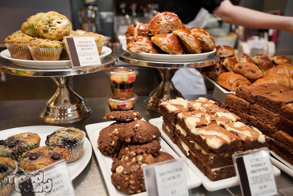Close-up view of fresh pastries on display in bakery