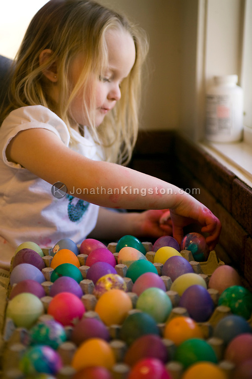 A young girl prepares for Easter by coloring eggs in vibrant shades of the rainbow. (releasecode: jk_mr1004) (Model Released)