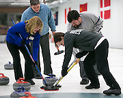 Carol Della Villa, Richard Dimperio, Megan Klein, and Tim Stames in action during a match at Rochester Curling Club on Sunday, February 8, 2015.