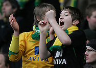 Huddersfield - Saturday, March 13th, 2010: Norwich City fans celebrate their teams win against Huddersfield Town during the Coca Cola League One match at the Galpharm Stadium, Huddersfield. (Pic by Michael Sedgwick/Focus Images)